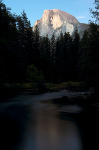 Yosemite National Park, Half Dome at sunset with Merced River in foreground